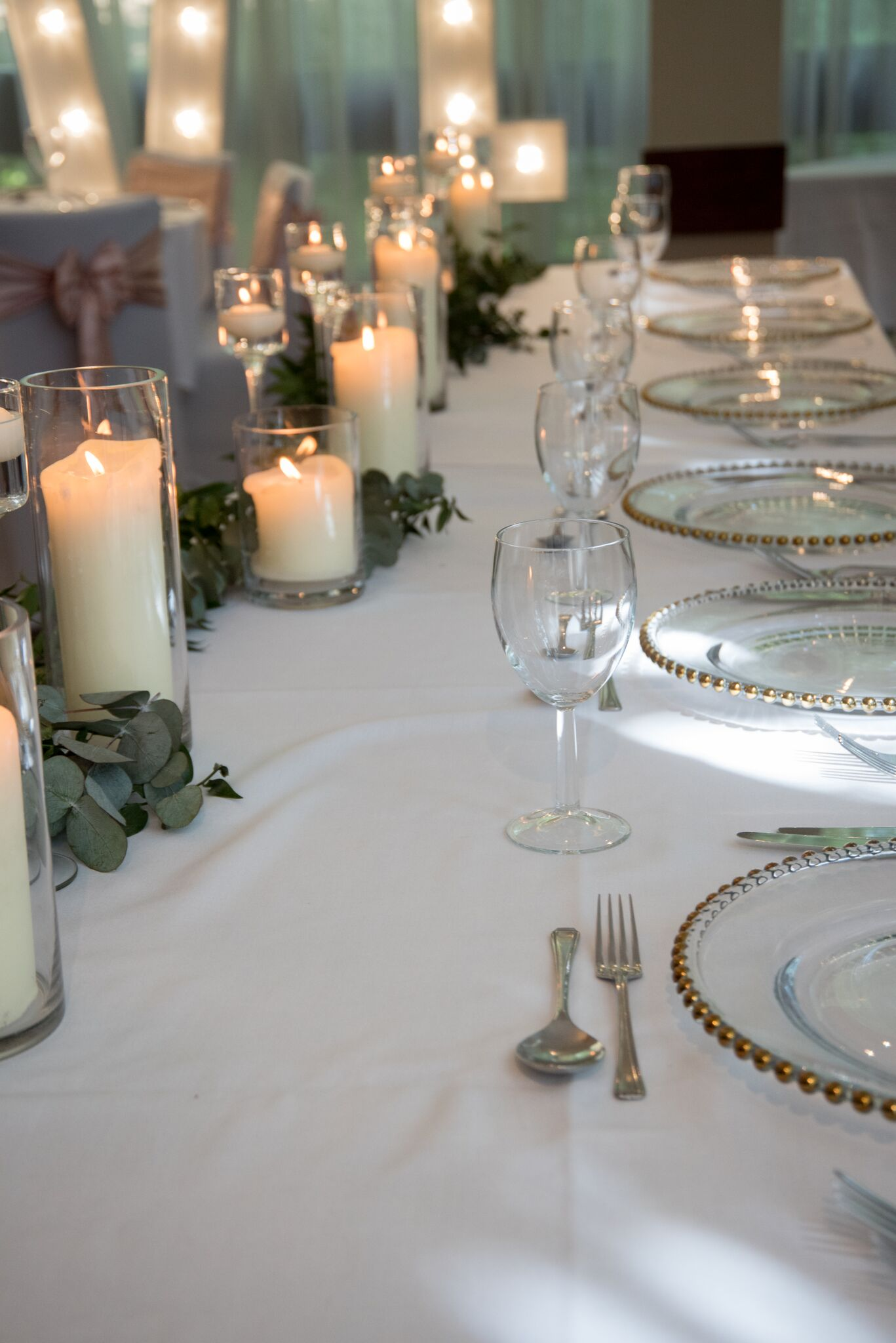 Cylinder & Floating candles with greenary Photography - Adele Drummond Sophia's Final Touch - Venue Styling - Weddings