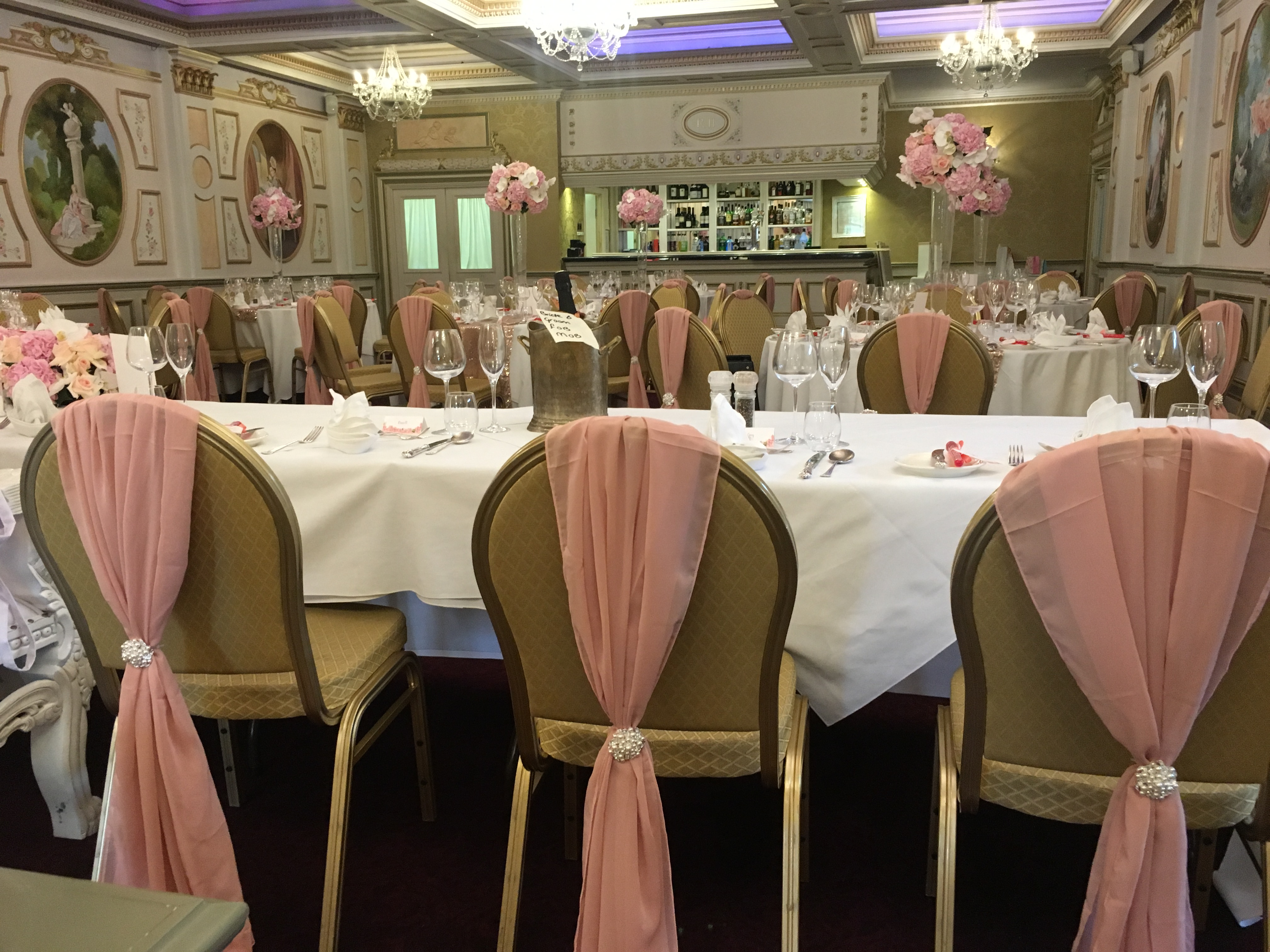 Rose Gold Chiffon Drop Chair Covers with Pearl Brooch Sophia's Final Touch - Venue Styling - Weddings