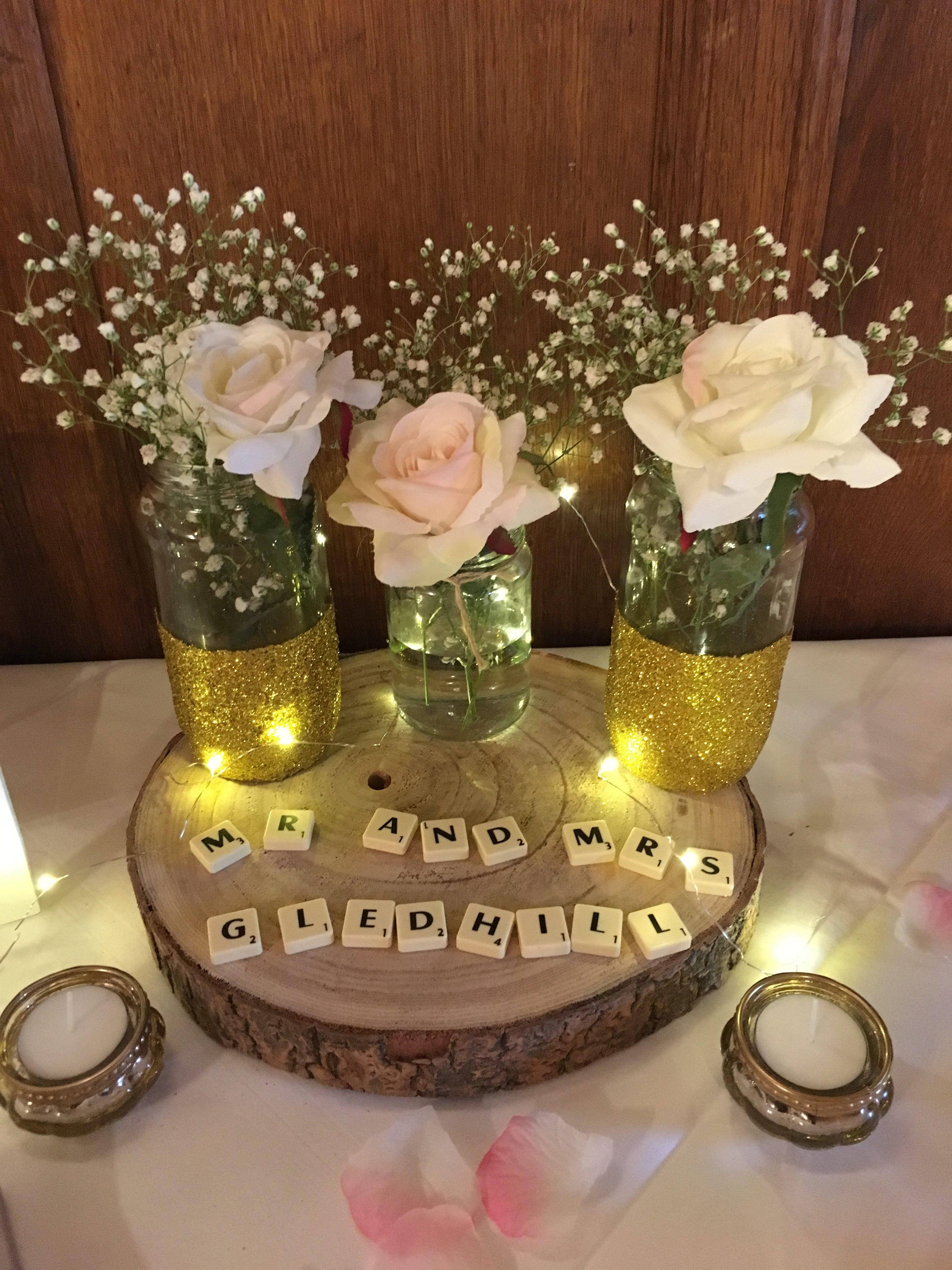 Rustic Logs with Glitter jars Sophia's Final Touch - Venue Styling - Weddings