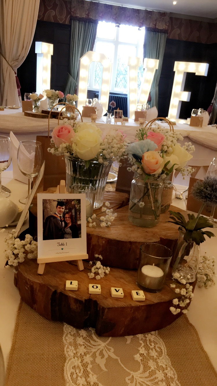 Rustic Stacked Logs with flowers and jars, Sophia's Final Touch - Venue Styling - Weddings