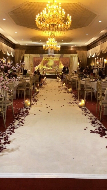 White Aisle Runner with rose Petal and Giant Rose Gold Lanterns – Crossley House – Wedding Venue Styling- Sophia's Final Touch