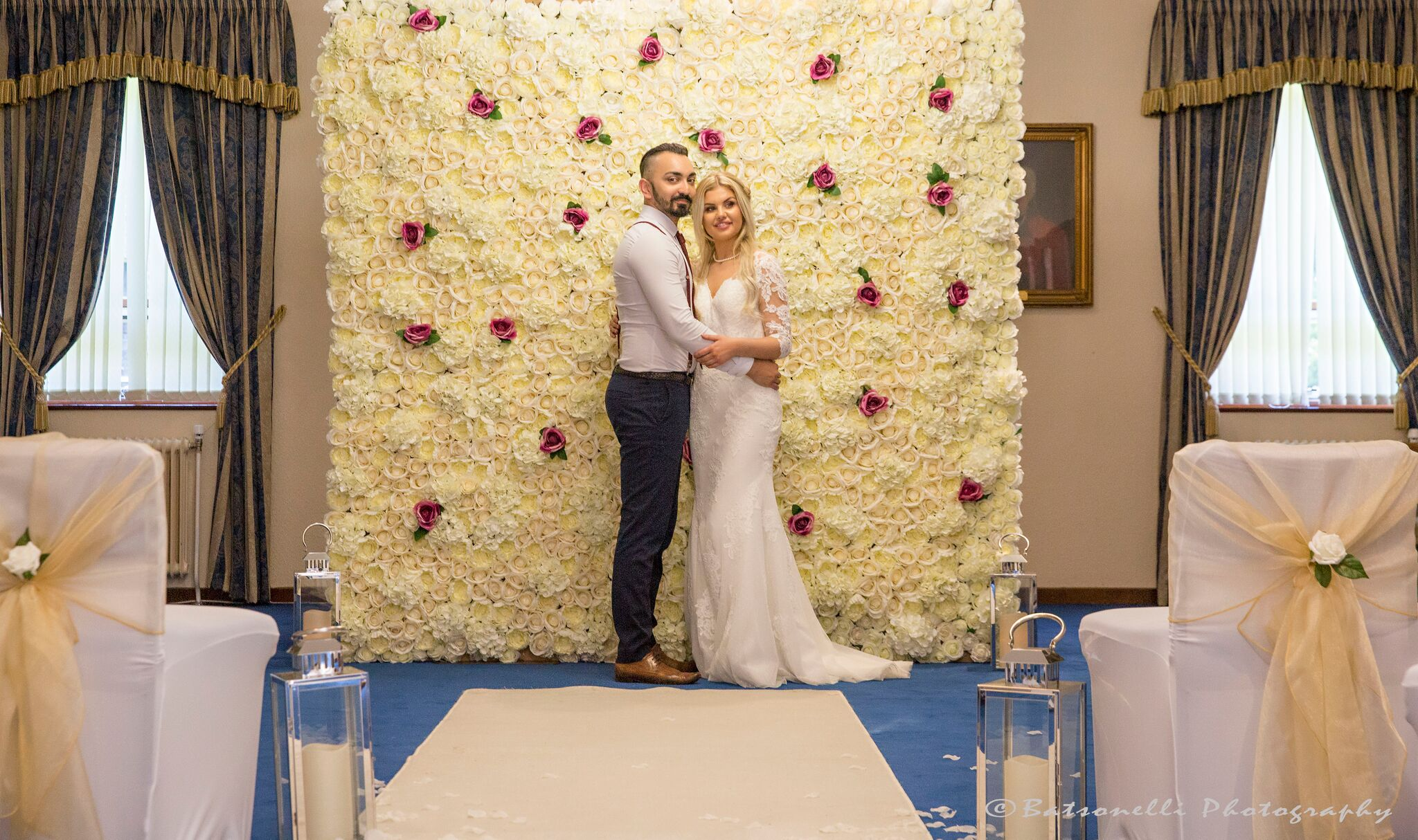 Cream and purple flower wall Photography Gill Baston Sophia's Final Touch - Venue Styling - Weddings